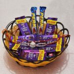 basket full of chocolates with rakhi