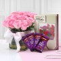 glass-vase-of-12-pink-roses-with-cadbury-dairy-milk-greeting-card