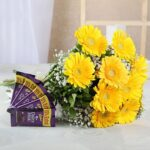 yellow flowers with chocolates