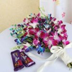 bouquet-of-5-purple-with-5-blue-orchids-2-bars-of-fruit-n-nut