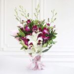 bunch-of-4-purple-orchids-2-lilies-in-tissue-wrapping