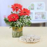 vase-arrangement-of-3-red-gerberas-with-kaju-katli-box