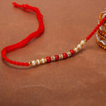 red-bead-and-pearl-dori-rakhi